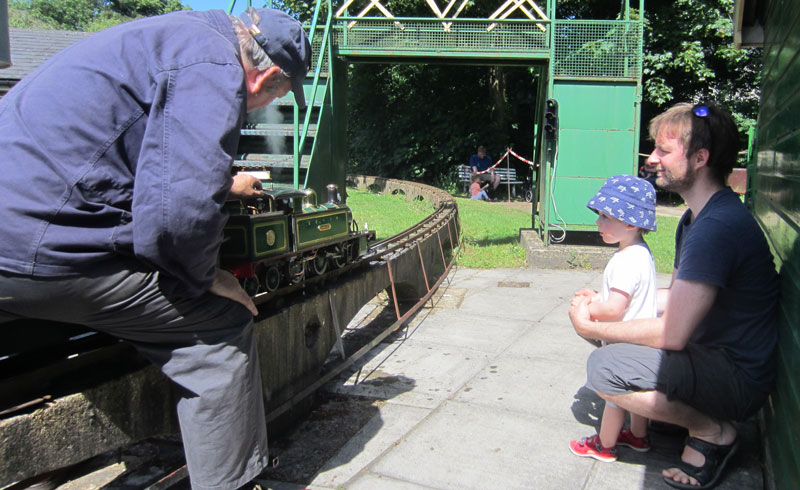 Classic photo of young boy looking at engine and driver